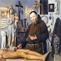 a monk as a wood sculptor